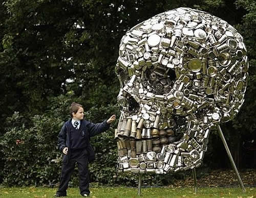 In The Air Giant Shiny Skull Crafted From Recycled Kitchen Utensils