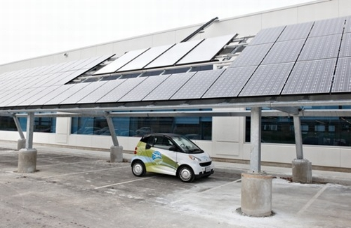 loyalty one carport with solar panels and plug in car Canadas Loyalty One Building Gets the Countrys Largest Rooftop Solar Panel Array