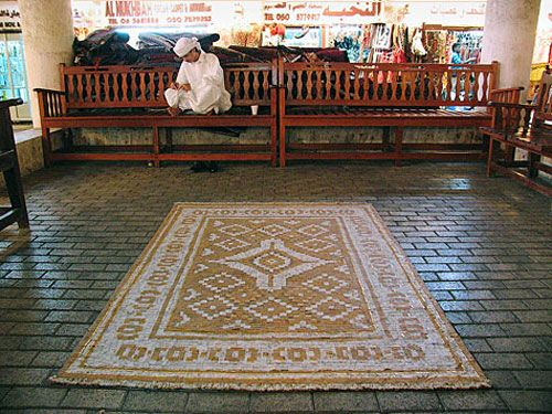carpet from cigarette butts Artist Makes Rug out of Cigarette Butts From Streets